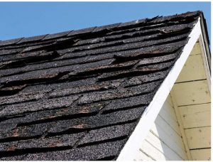 image shows missing shingles on roof needing replacement by Patriots Roofing