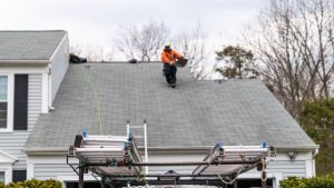image show Patriots' Roofing roofer working on a roof in North Carolina
