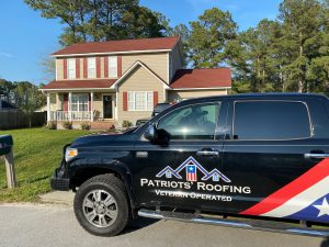image shows Patirots' Roofing truck in front of new roof installed on Fayetteville NC Home